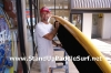 Attaching Handles on Stand Up Paddle Board at Wet Feet Hawaii