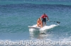 zane-and-shelby-schwietzer-tandem-sup-surfing-04