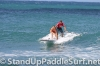 zane-and-shelby-schwietzer-tandem-sup-surfing-05