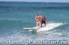 zane-and-shelby-schwietzer-tandem-sup-surfing-06