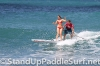 zane-and-shelby-schwietzer-tandem-sup-surfing-08