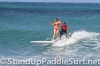 zane-and-shelby-schwietzer-tandem-sup-surfing-09