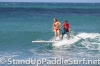 zane-and-shelby-schwietzer-tandem-sup-surfing-10