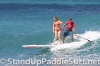 zane-and-shelby-schwietzer-tandem-sup-surfing-11