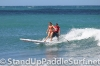 zane-and-shelby-schwietzer-tandem-sup-surfing-16