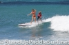 zane-and-shelby-schwietzer-tandem-sup-surfing-17