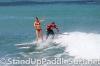 zane-and-shelby-schwietzer-tandem-sup-surfing-26