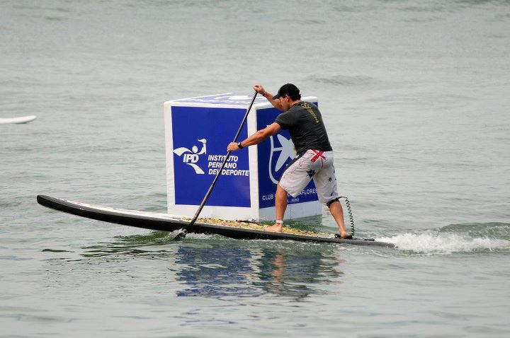 Travis Grant rounds a buoy during the ISA SUP Technical Race Finals on Friday.